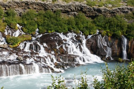 hraunfossar waterfall. Vacation tours for singles